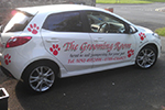 Vinyl lettering and logos to dog grooming vehicle